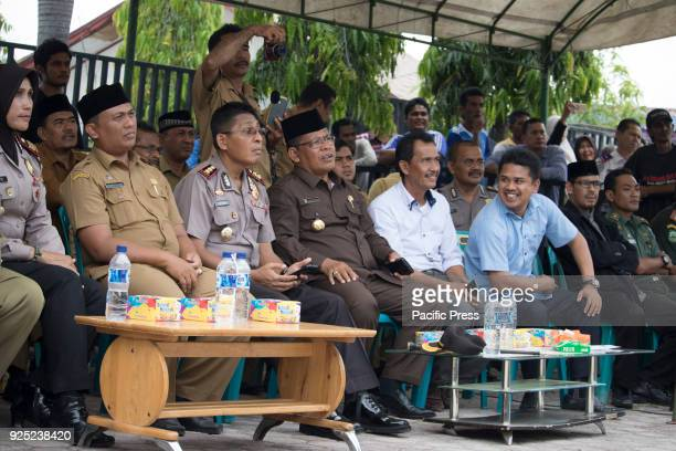 Government officers are watching a flogged punishment in a mosque in Aceh province Indonesia As many as five Indonesian people two of them are...