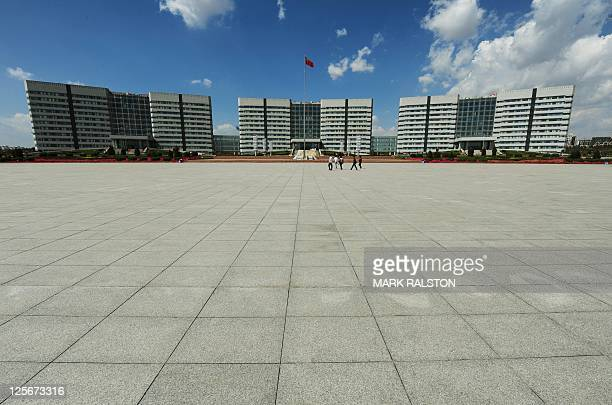 Government offices rise behind a square in the city centre of Ordos Inner Mongolia on September 12 2011 The city which is commonly referred to as a...