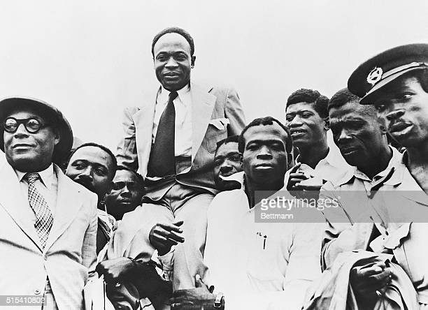 Government officials carry Prime Minister Kwame Nkrumah on their shoulders after Ghana obtains its independence from Great Britain