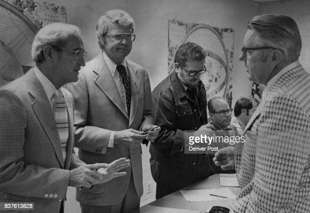 Government Officials Confer On Assistance To Survivors Of Big Thompson Flood Standing from left US disasterassistance official Don Eddy Gov Dick Lamm...