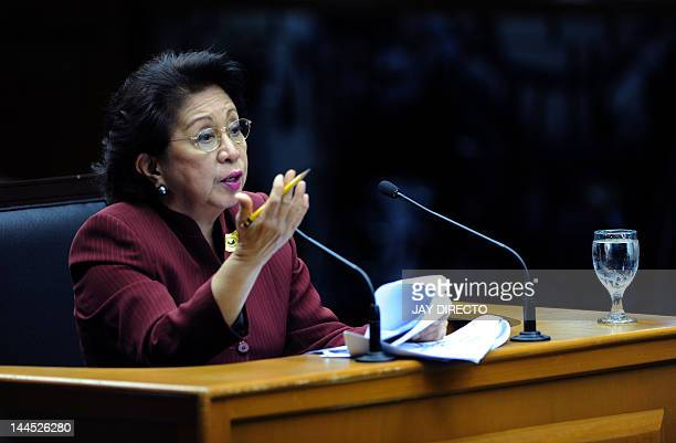 Government Ombudsman Conchita CarpioMorales gestures as she gives a power point presentation showing the alleged US dollar accounts of Supreme Court...