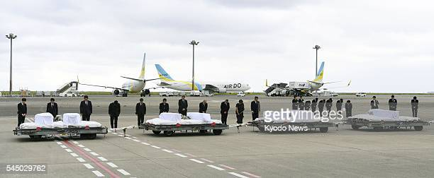 A government plane carrying the bodies of seven Japanese victims of the terrorist attack in the Bangladeshi capital of Dhaka arrives at Tokyo's...