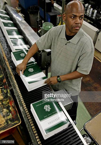 S Government Printing Office employee Jeffrey Hayden inspects copies of the US President George W Bush Administration's budget for the 2008 fiscal...
