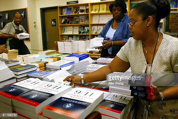 S Government Printing Office employees Regina Mitchell and Pat SimmonsDatcher stack up copies of the final report of the National Commission on...