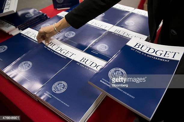 A Government Printing Office staff member arranges copies of US President Barack Obama's Fiscal Year 2015 Budget at the GPO bookstore in Washington...