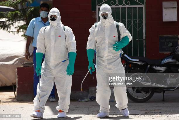 Government Public Health employees in PPE chemically disinfect the residence of a 48 year old male who was tested positive for Covid19 with a travel...