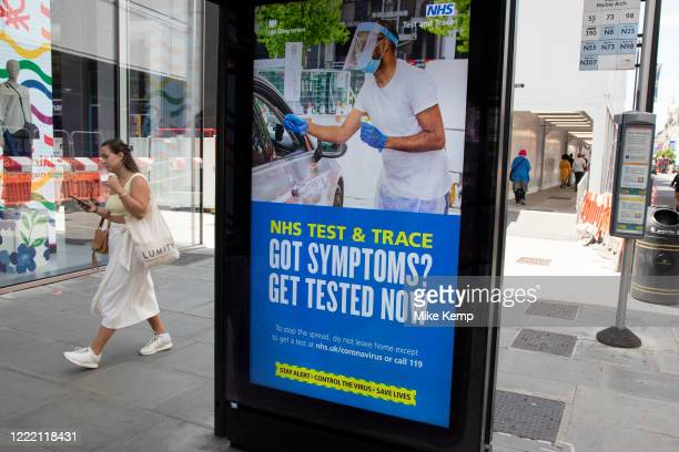 HM Government Public Health England NHS advertising boards advice to stay alert to the symptoms as part of the test and trace program as the...