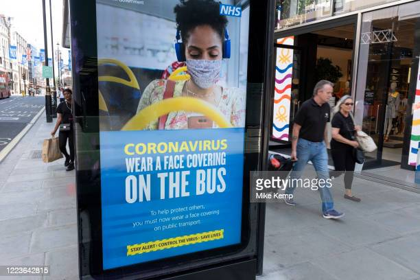 HM Government Public Health England NHS advertising boards advise people to take precaution of wearing a face mask as some nonessential shops reopen...