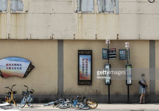 Government slogans displayed at a bus stop in Shanghai, China, on Monday, Aug. 30, 2021. Chinese PresidentXi Jinpingchaired a high-level meeting...