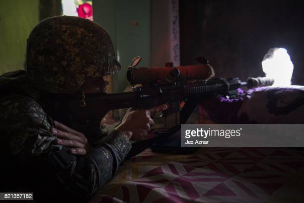 A government sniper training his sight on enemy positions on July 22 2017 in Marawi southern Philippines The Philippine Congress voted on Saturday to...