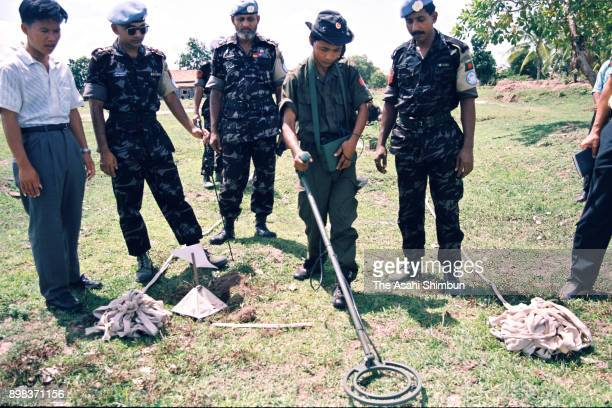 A government soldier learns land mine removal operation from Bangladesh soldiers deploying to the United Nations Transitional Authority in Cambodia...