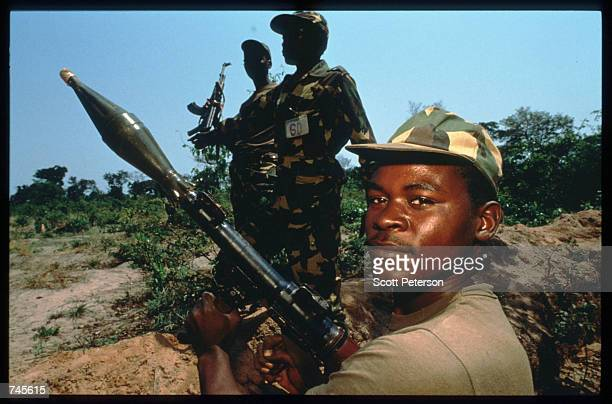 A government soldier poses with a grenade launcher October 25 1993 in Menogue Angola Angolan rebels have continued the civil war after losing...