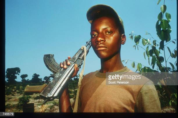 A government soldier poses with his AK47 October 25 1993 in Menogue Angola Angolan rebels have continued the civil war after losing elections on...