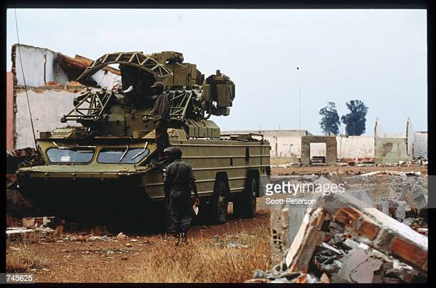 A government soldier walks by a mobile radar station October 25 1993 in Menogue Angola Angolan rebels have continued the civil war after losing...