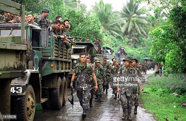 Government soldiers arrive May 2 2000 in Talipao Sulu to prevent the escape of members of Abu Sayyaf The Abu Sayyaf is the smaller of two Muslim...