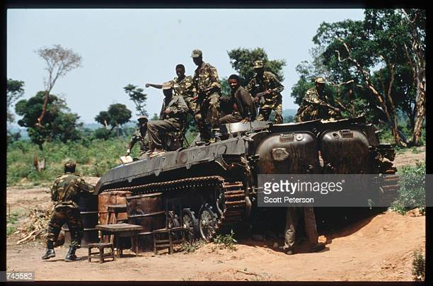 Government soldiers sit atop an armored personnel carrier October 25 1993 in Menogue Angola Angolan rebels have continued the civil war after losing...