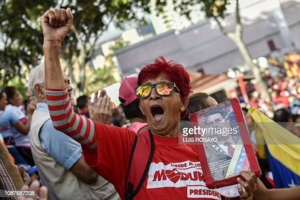 Government supporters listen to Venezuelan President Nicolas Maduro speaking at the Miraflores Palace during a rally in which he announced that his...