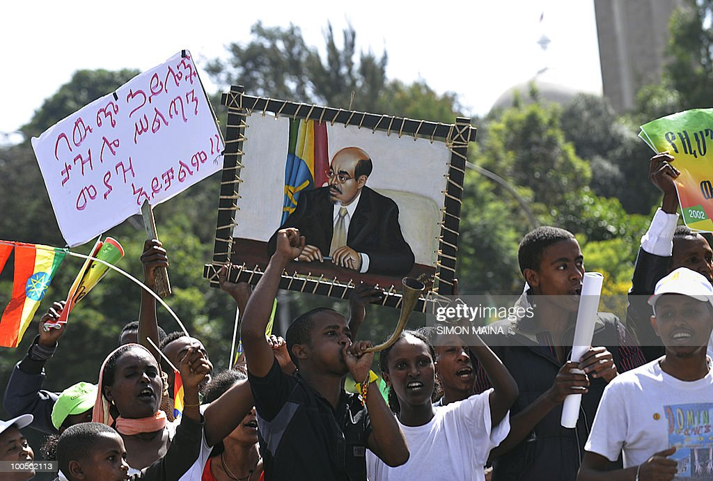 Government supporters of Ethiopian People's Revolutionary Democratic Front (EPRDF) carry placards criticizing Foreign Rights groups at the Meskel Square in Addis Ababa on May 25,2010 as they celebrate their party's victory in the just concluded national election. The rally was organized as provisional returns showed a victory for the ruling Ethiopian People's Revolutionary Democratic Front and its allies.Sunday's vote had been closely watched by international observers after the contentious 2005 election, in which the opposition won a majority number of parliamentary seats only to endure police crackdowns and the killing of 193 demonstrators after the votes were counted.