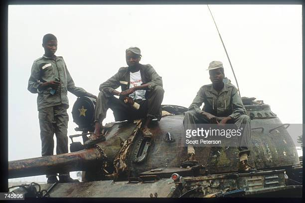 A government tank crew sits atop a T55 tank October 25 1993 in Menogue Angola Angolan rebels have continued the civil war after losing elections on...