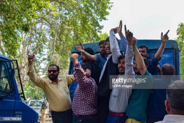 LAL CHOWK SRINAGAR JAMMU KASHMIR INDIA Government teachers shouts anti government slogans in a Police vehicle after detention during anti government...
