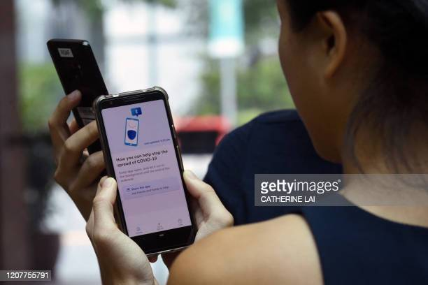 Government Technology Agency staff demonstrate Singapore's new contacttracing smarthphone app called TraceTogether as a preventive measure against...