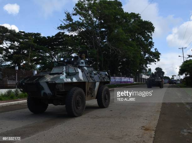 Government troops aboard their armored personnel carriers arrive to reinforce their colleagues in Marawi in southern island of Mindanao on June 2...