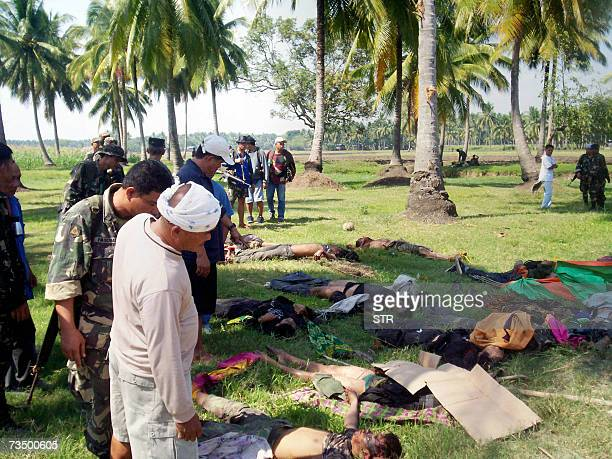 Government troops gather bodies of slain Muslim separatist rebels of the Moro Islamic Liberation Front in Midsayap town in southern Philippine island...