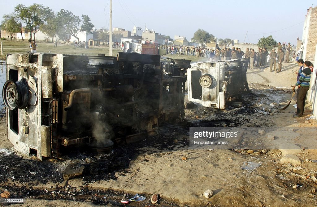 Government vehicles burnt during clash between residents of Sheetla Colony and police while demolition of illegal construction by administration on December 21, 2012 in Gurgaon, India. Police has arrested some people in the case.