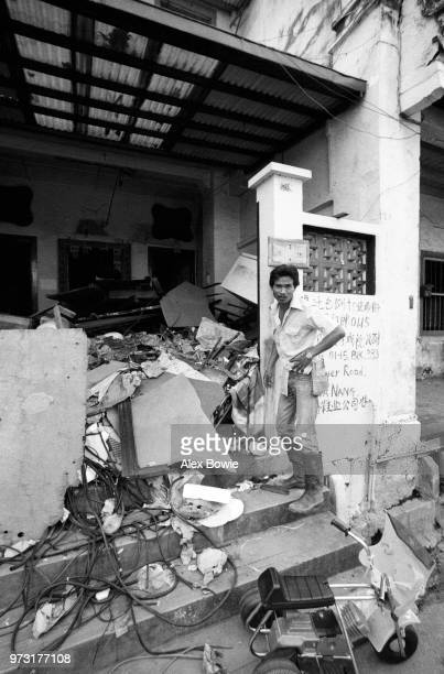 Government worker checks that this Craig Rd shophouse is vacant before demolition begins Chinatown Singapore 12 July 1983 The Craig Place condominium...