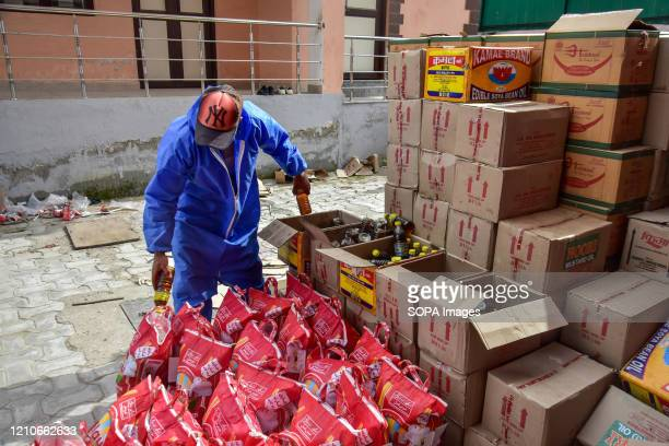 KASHMIR JAMMU KASHMIR INDIA A government worker packs bottles of cooking oil for distribution among the vulnerable people ahead of the holy month of...