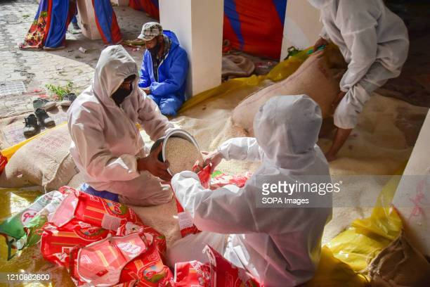 KASHMIR JAMMU KASHMIR INDIA Government workers pack rice for distribution among the vulnerable people ahead of the holy month of Ramadan in Kashmir...