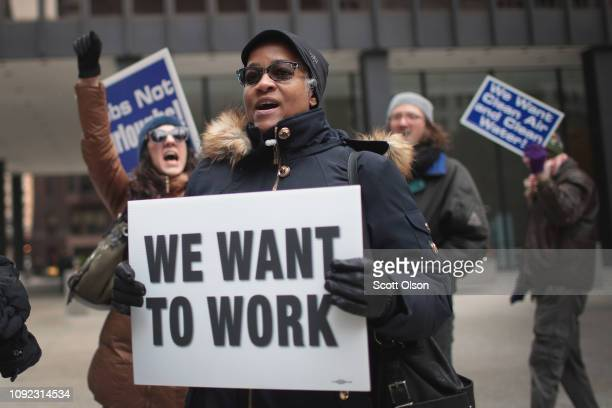Government workers protest the government shutdown during a demonstration in the Federal Building Plaza on January 10 2019 in Chicago Illinois The...