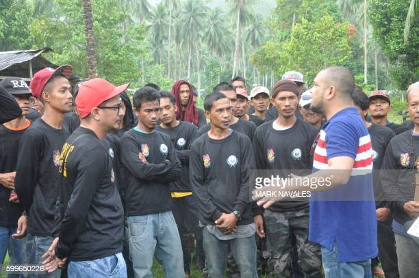 Governor Abdusakar Tan talks to village militia who volunteered to fight against the Abu Sayyaf group during a dialogue with residents in Patikul...