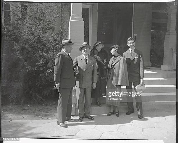 Governor and Mrs Alf M London are shown with Mr and Mrs Paul Block and son at the Governor's mansion in Topeka leaving for the football game between...