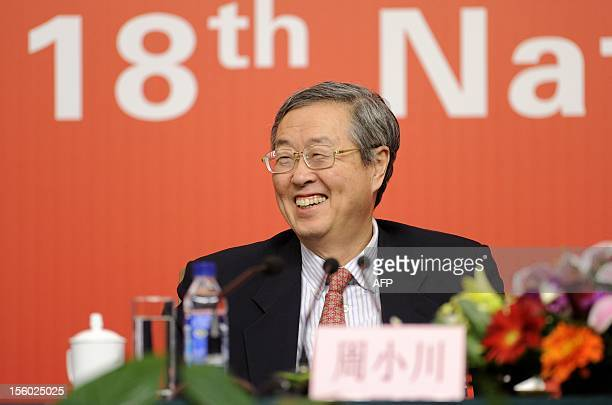 Governor and secretary of the CPC Party Committee of the People's Bank of China, Zhou Xiaochuan reacts at a press conference during the 18th National...