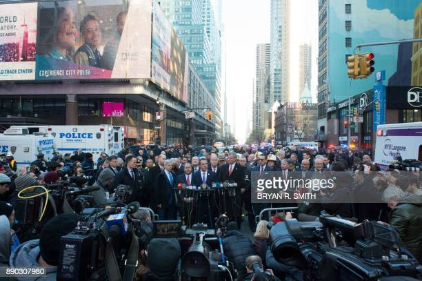 Governor Andrew Cuomo and NYC Mayor Bill de Blasio speak at a press conference as police respond to a reported explosion at the Port Authority Bus...