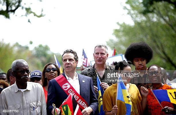 Governor Andrew Cuomo New York Mayor Bill de Blasio along with his daughter Chiara de Blasio son Dante de Blasio and wife Chirlane McCray prepare to...