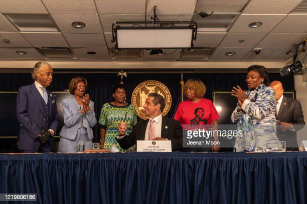 Governor Andrew Cuomo signs the Say Their Name reform during the daily media briefing as he is joined by Rev Al Sharpton Dr Hazel N Dukes Valerie...
