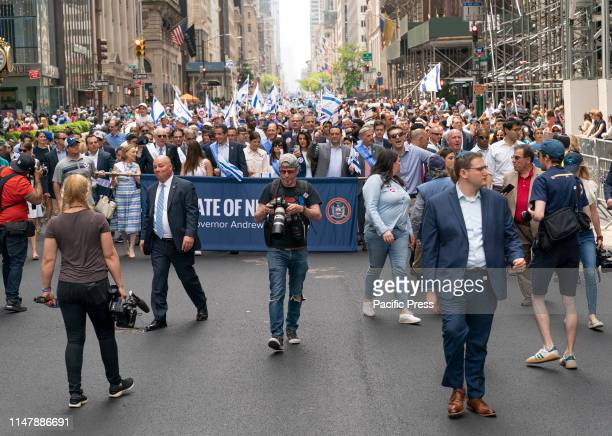 Governor Andrew Cuomo with daughters Cara and Michaela marches on 55th to Celebrate Israel Parade in New York on 5th Avenue