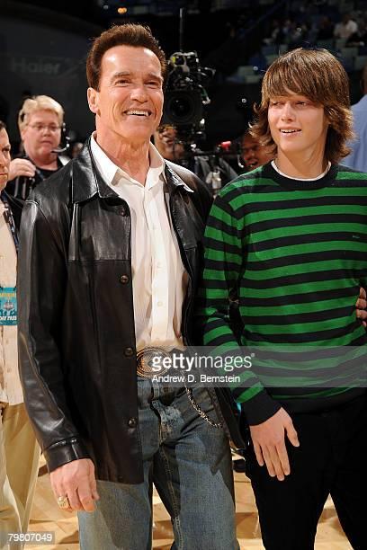 Governor Arnold Schwarzenegger of California and son Patrick Schwarzenegger look on during NBA AllStar Saturday Night part of 2008 NBA AllStar...