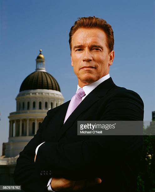 Governor Arnold Schwarzenegger poses for Fortune Magazine in front of the Capitol Building in Sacramento, California on July 2, 2004.