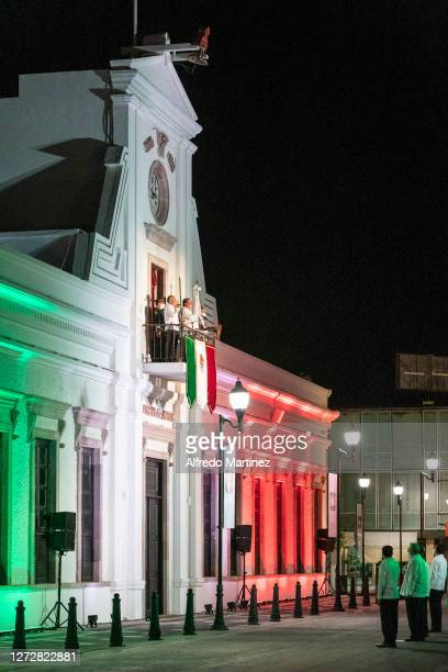 Governor Carlos Mendoza Davis gives El Grito de Independencia from the balcony at the Museum of Art as part of the Independence Day celebrations on...