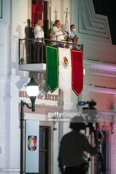 Governor Carlos Mendoza Davis gives El Grito de Independencia from the balcony of the Museum of Art as part of the Independence Day celebrations on...