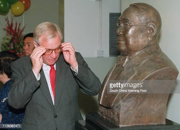 Governor Chris Patten moves in for a close look at the statue of philanphropist Mr Fung Hon Chu at the Fung Hon Chu Gifted Education Centre in Tseun...