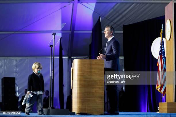 Governor Gavin Newsom delivers his inaugural address as his son Dutch walks on stage on January 7 2019 in Sacramento California Gavin Newsom will...