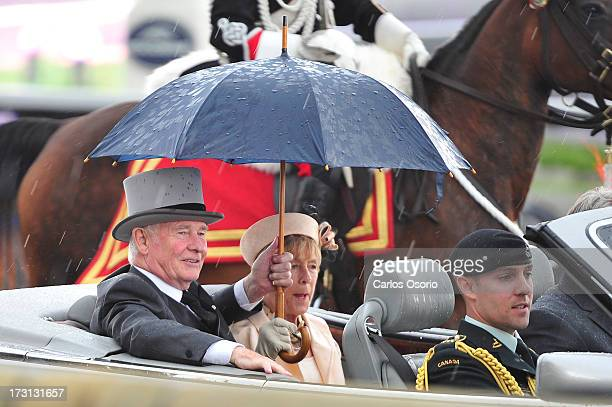Governor General David Johnston and his wife Her Excellency Sharon Johnston arrive at Sunday's Queen's Plate at Woodbine racetrack.