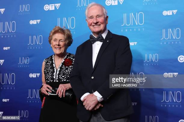 Governor General David Johnston and his wife Sharon arrive on the red carpet before the JUNO awards at the Canadian Tire Centre in Ottawa Ontario on...