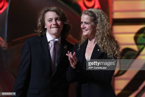Governor General Julie Payette receives a hug from her son Laurier Payette Flynn during a reception at the Canadian Museum of History in Gatineau,...