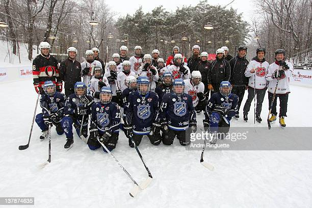 Governor General of Canada David Johnston and TV and radio personality George Stroumboulopoulos pose for a photo with hockey young fans during the...