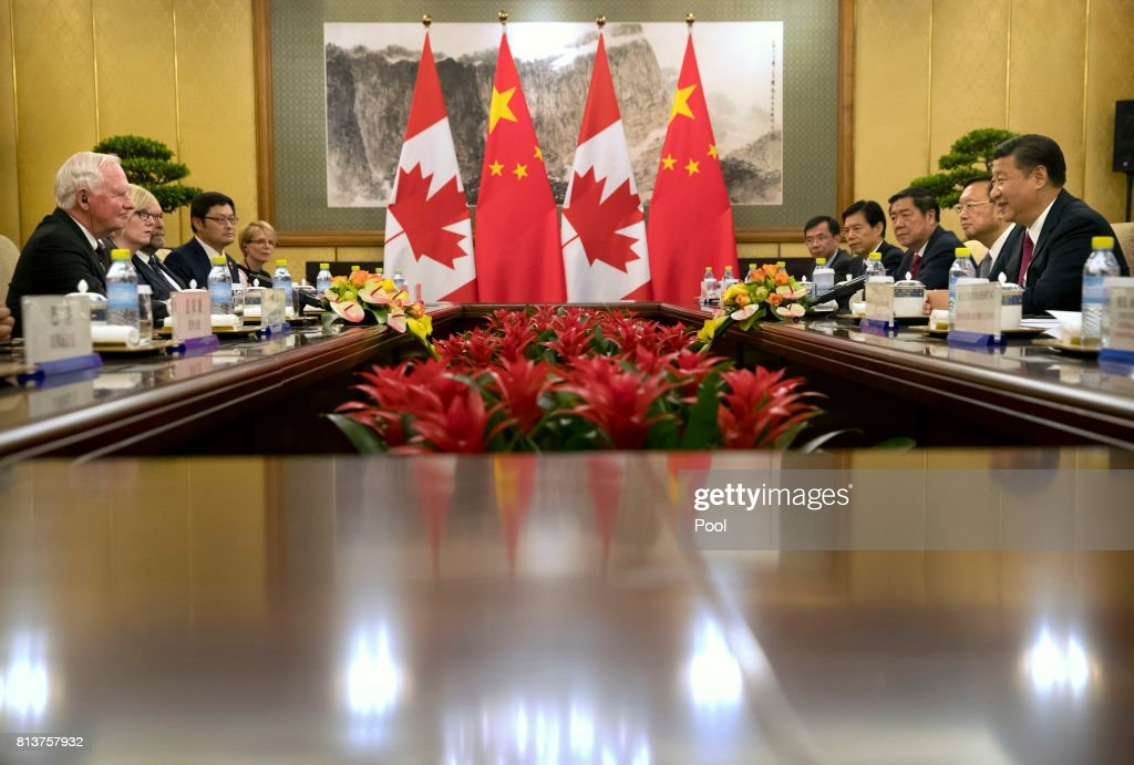 Governor General of Canada David Johnston, left, meets with Chinese President Xi Jinping, right, at the Diaoyutai State Guesthouse on July 13, 2017 in Beijing, China.